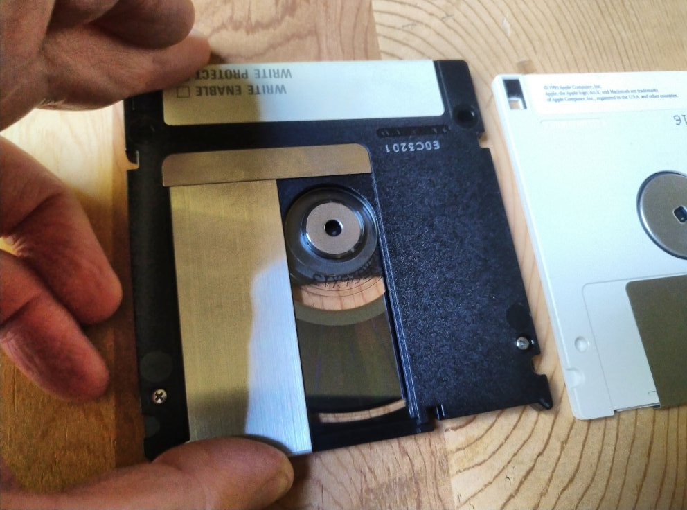 disk side by side with floppy, MO opened