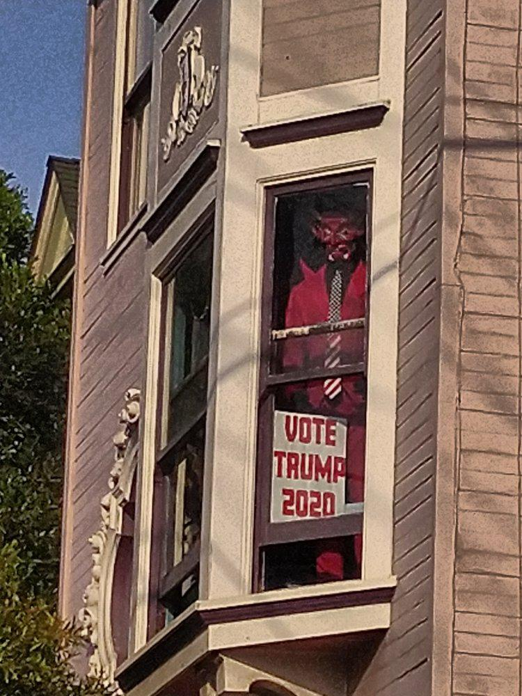 Closer still, showing mannequin with VOTE TRUMP sign is the Devil
